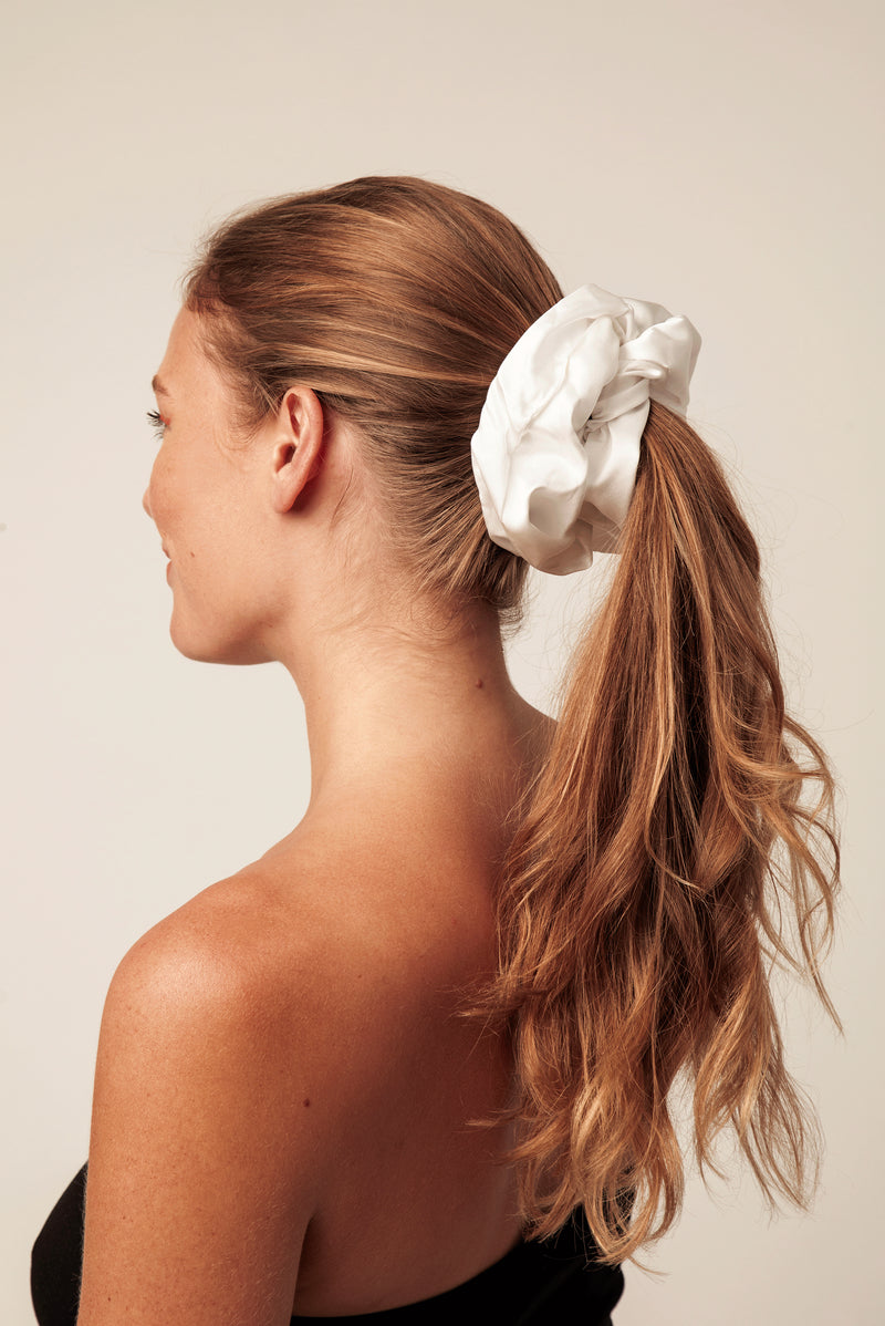Shayne oversized silk scrunchie in white. Less damaging hair ties.