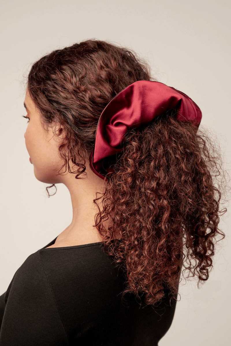 Large 100% silk scrunchie in maroon.