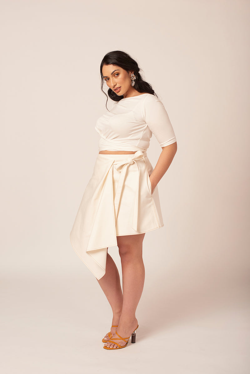 Oversized bow on a white denim skirt at shayne