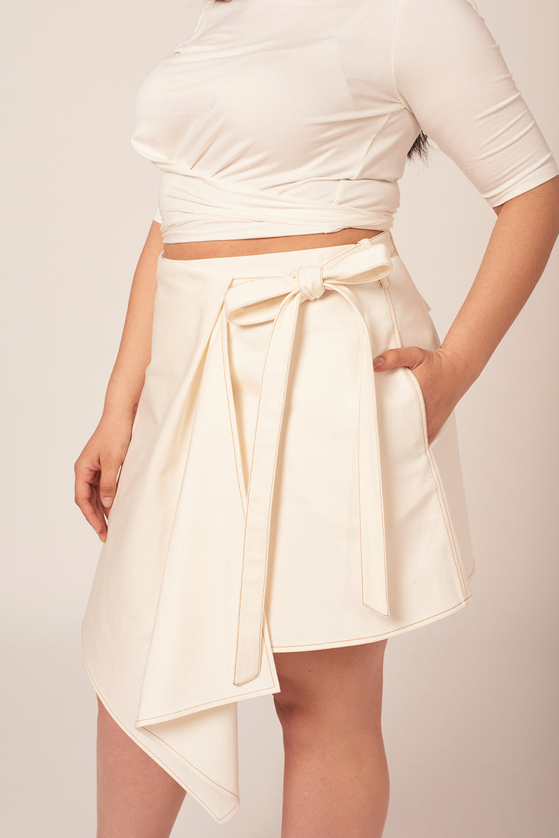 White denim skirt with pockets at Shayne. Available for plus size women up to size 18