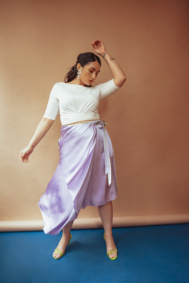 Dance the night away in this high end designer purple silk skirt. Made in NYC