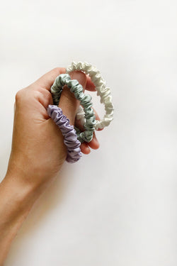 Small silk scrunchie set for $20 at Shayne. Purple, mint, and white.