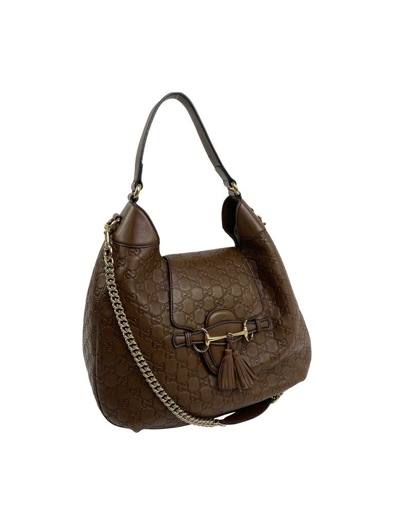 gucci monogram embossed leather shoulder bag brown