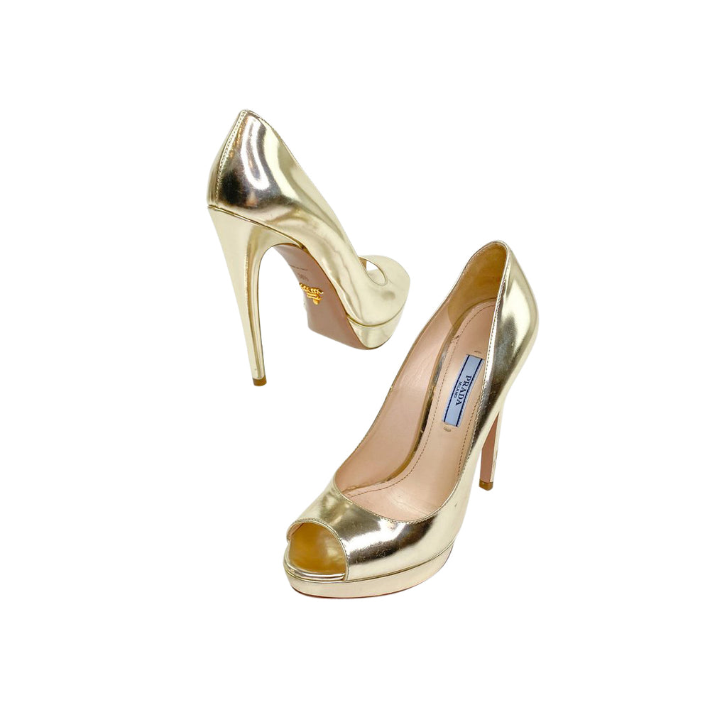Prada pumps gold