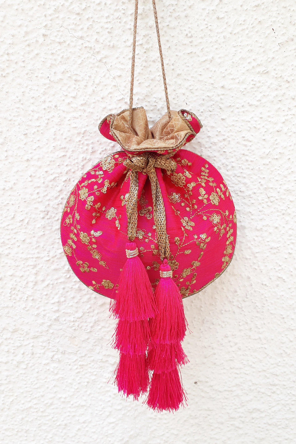 Pink embroidered silk potli