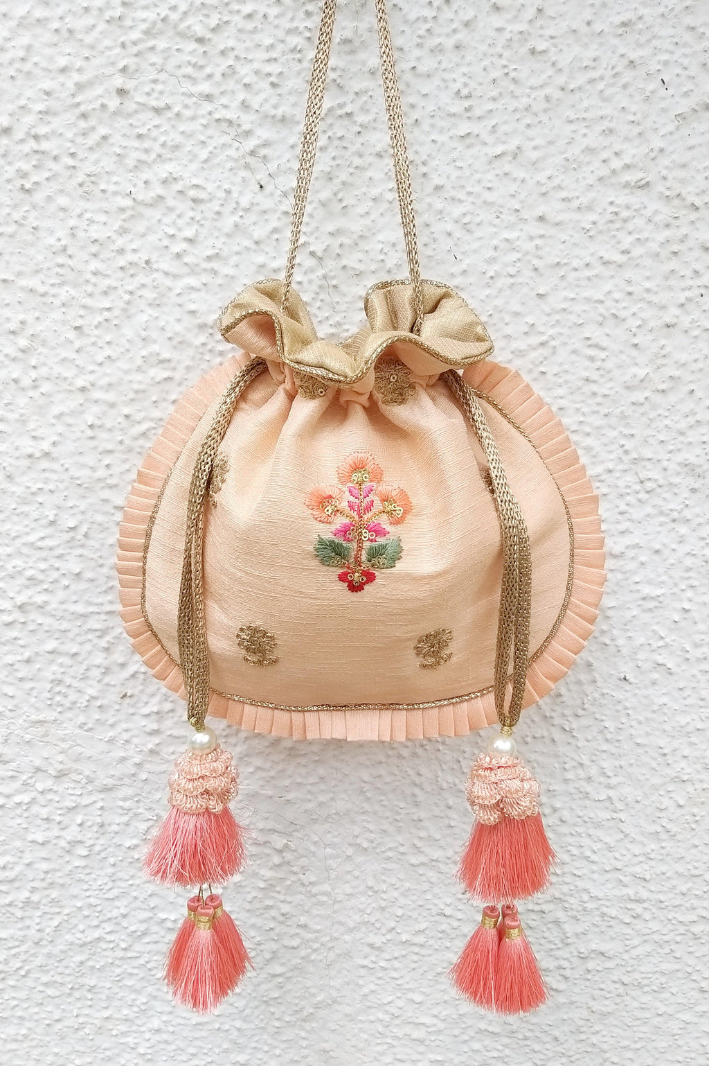 Peach pleated silk potli