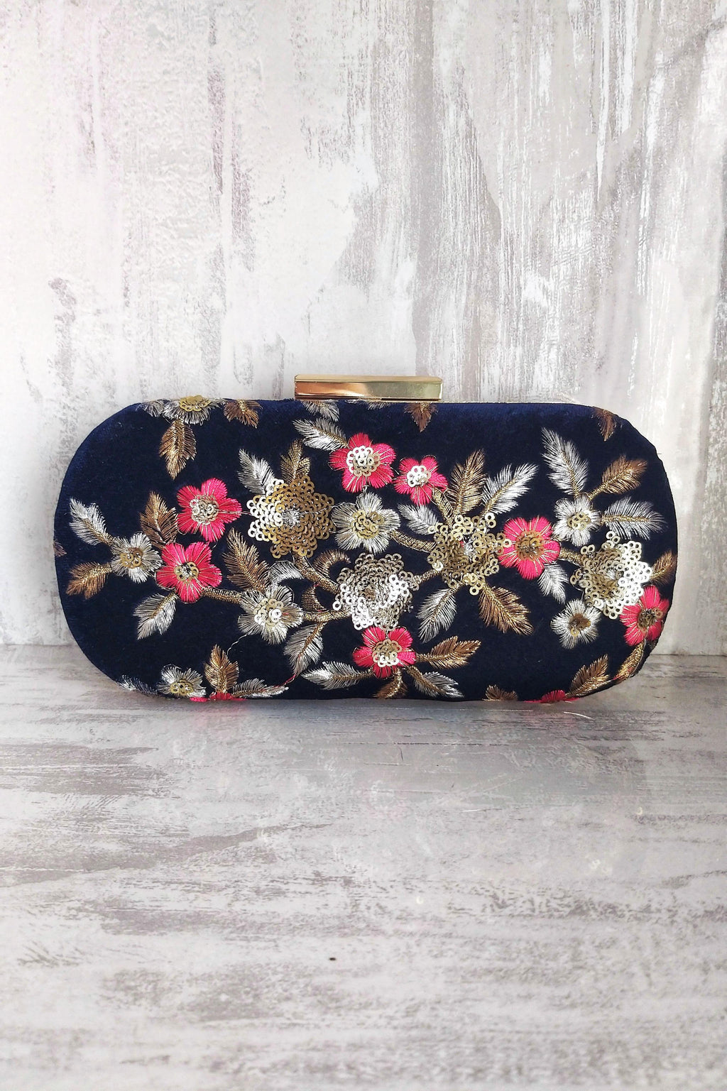 Midnight garden capsule clutch