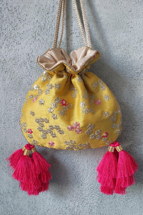 AMYRA Azalea Yellow And Hot Pink Tassle Potli