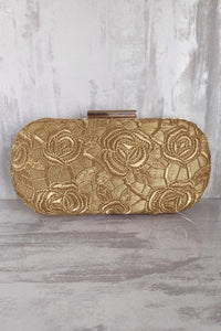 AMYRA Gold Cutwork Capsule Clutch