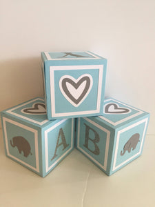 blue and white alphabet blocks, baby boy decorations, elephant baby shower for a boy