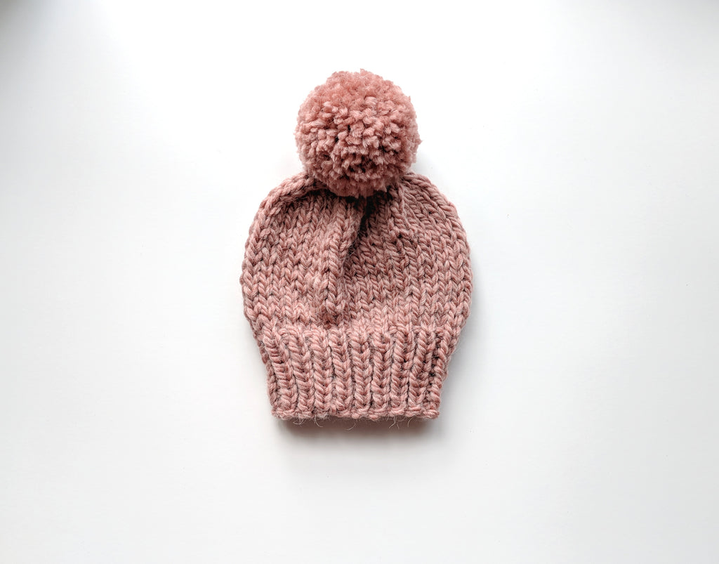dusty rose pom pom knit hat