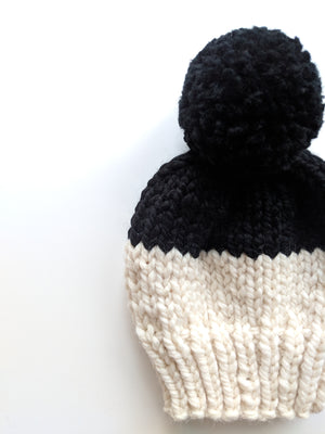cream black pom pom knit hat