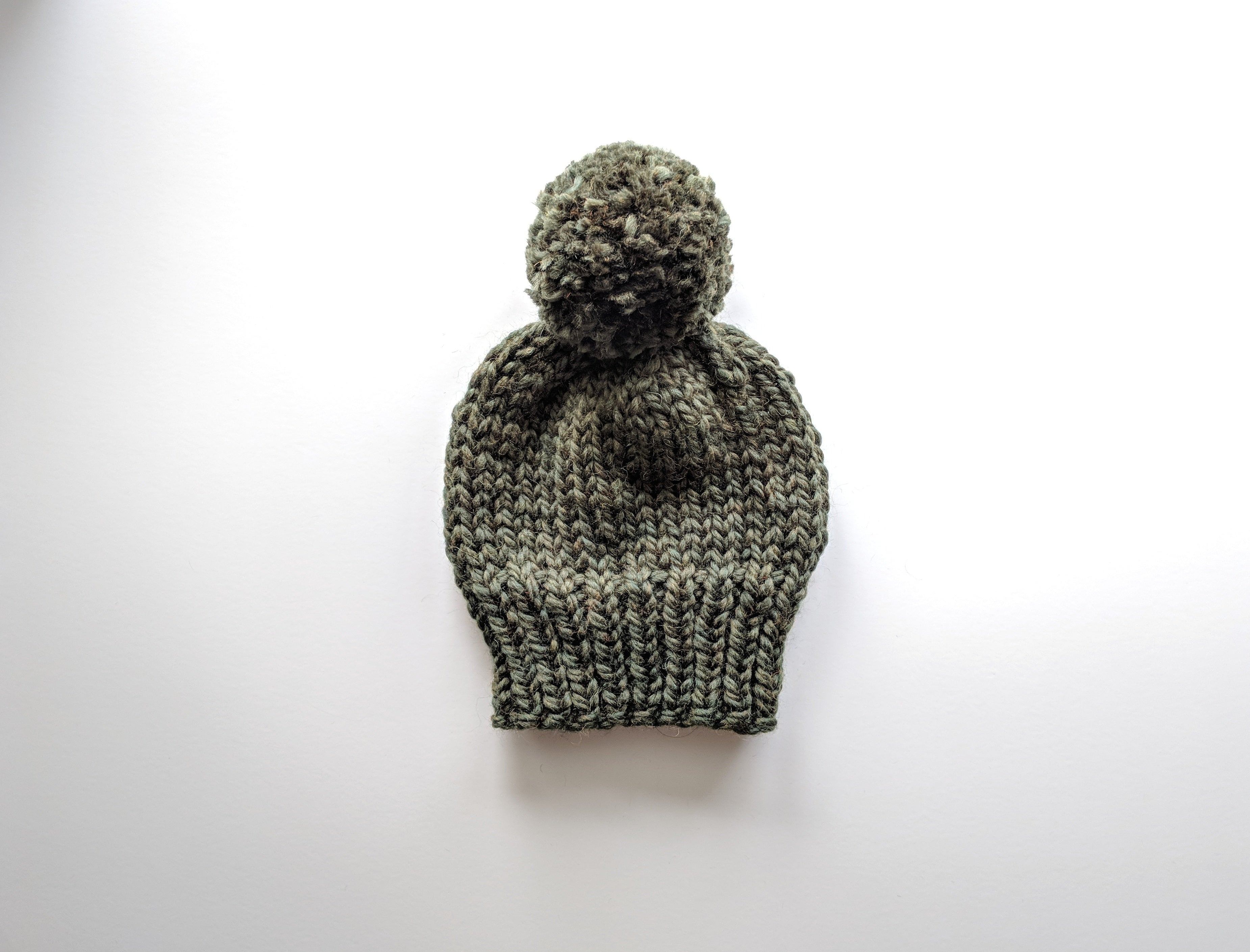 forest pom pom knit hat