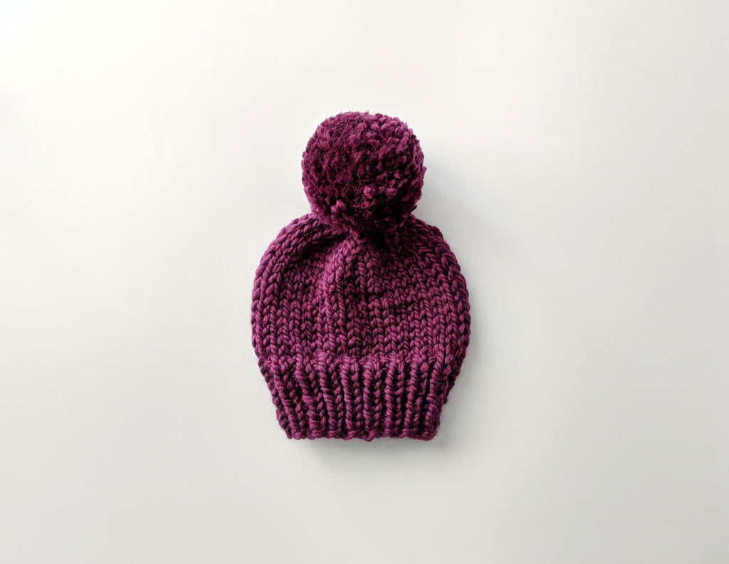 adult plum pom pom knit hat
