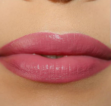 light skin model's lips with mid tone creamy rose shade