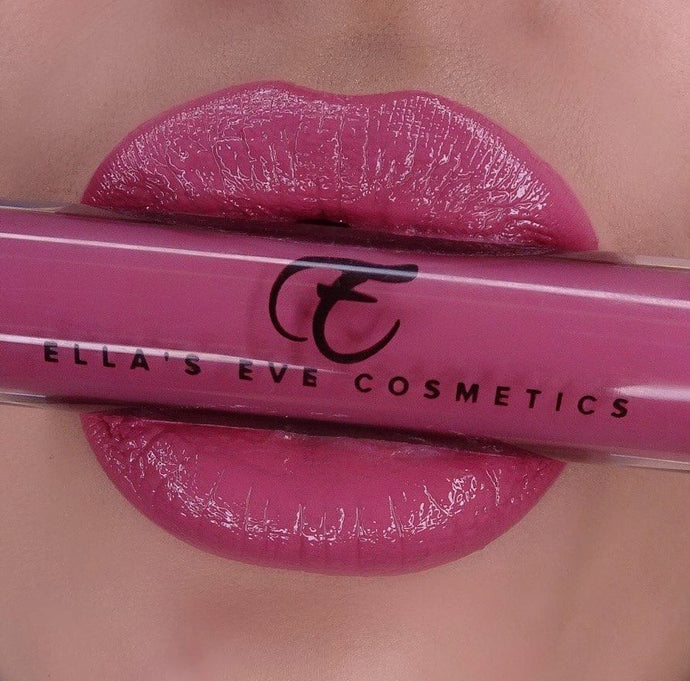 image of rosy lips holding lip gloss bottle of rosy shade