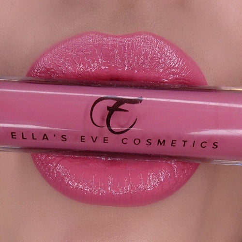 image of pink lips holding lip gloss bottle in pink shade