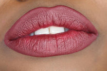 Load image into Gallery viewer, deep skin model's lips with mid tone wine berry shade matte lipstick