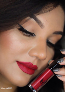 olive skin model wearing a ruby red berry lipstick