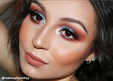 Load image into Gallery viewer, olive skin model wearing valentina lip shade - toasty nude shade