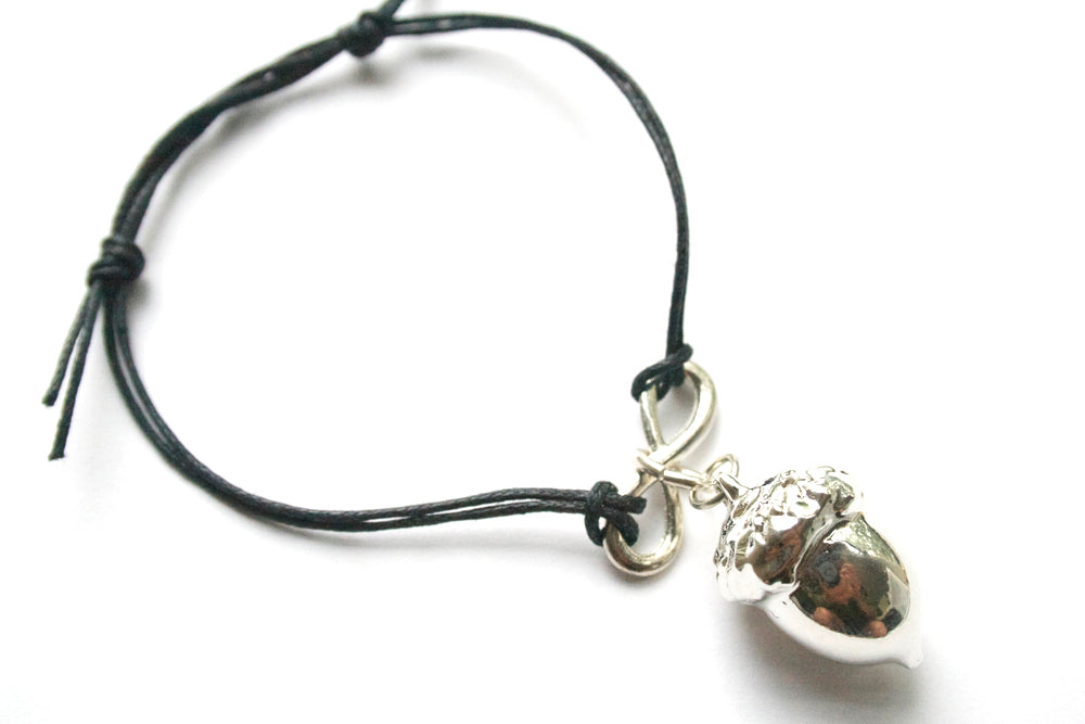 Real Acorn bracelet in silver with black cord - Arborvita Real leaf jewellery