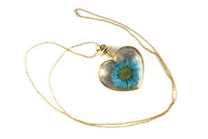 Real Oxeye Daisy resin necklace blue in gold