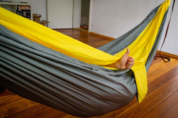 wrapped up in a large parachute hammock