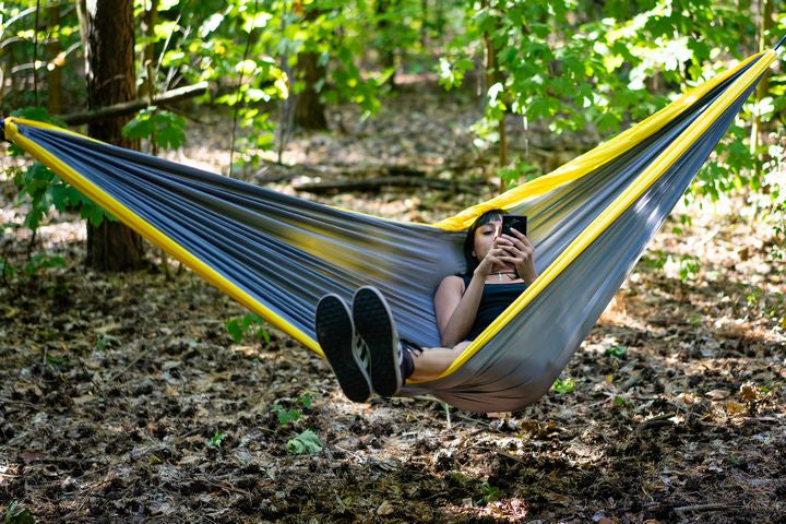 relaxing outdoors in parachute hammock