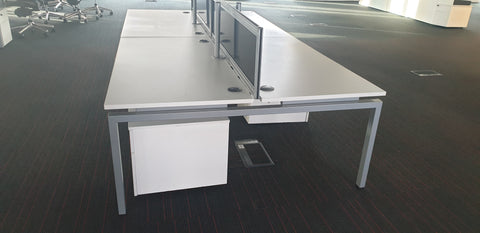 High quality bank of 4 desks with screens - Milton Keynes