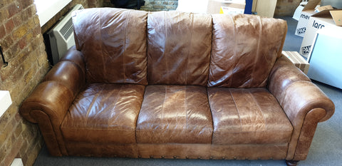 Leather sofa comes with matching footstool
