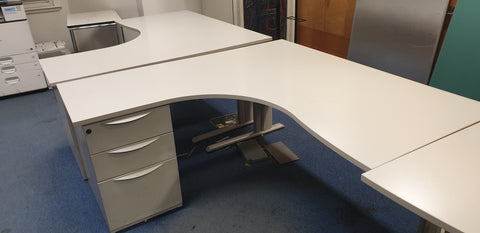 Corner desk left return with wave edge and desk supporting pedestal