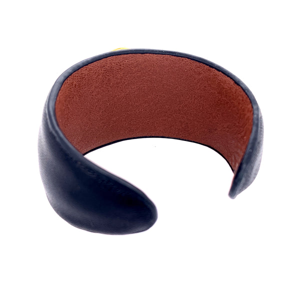 So HOT for Fall - This Leather Statement Ruby Cuff will have Heads Turning!      AAA Faceted Indian Ruby - Approx 35MM     Fine Leather Black or Grey Cuff with Saddle Interior     Bezel 18kt Gold Vermeil     Size - One size fits most (Approx 7 inches) - Is Flexible