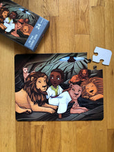 In The Lions' Den Puzzle (13in x 10in w/ 24 Pieces)