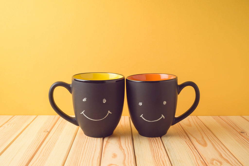 smiling coffee cups