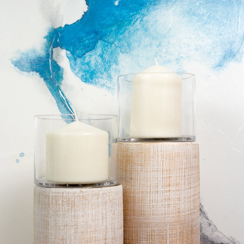 Pairing a few candleholders with different sizes for a warm and modern interior