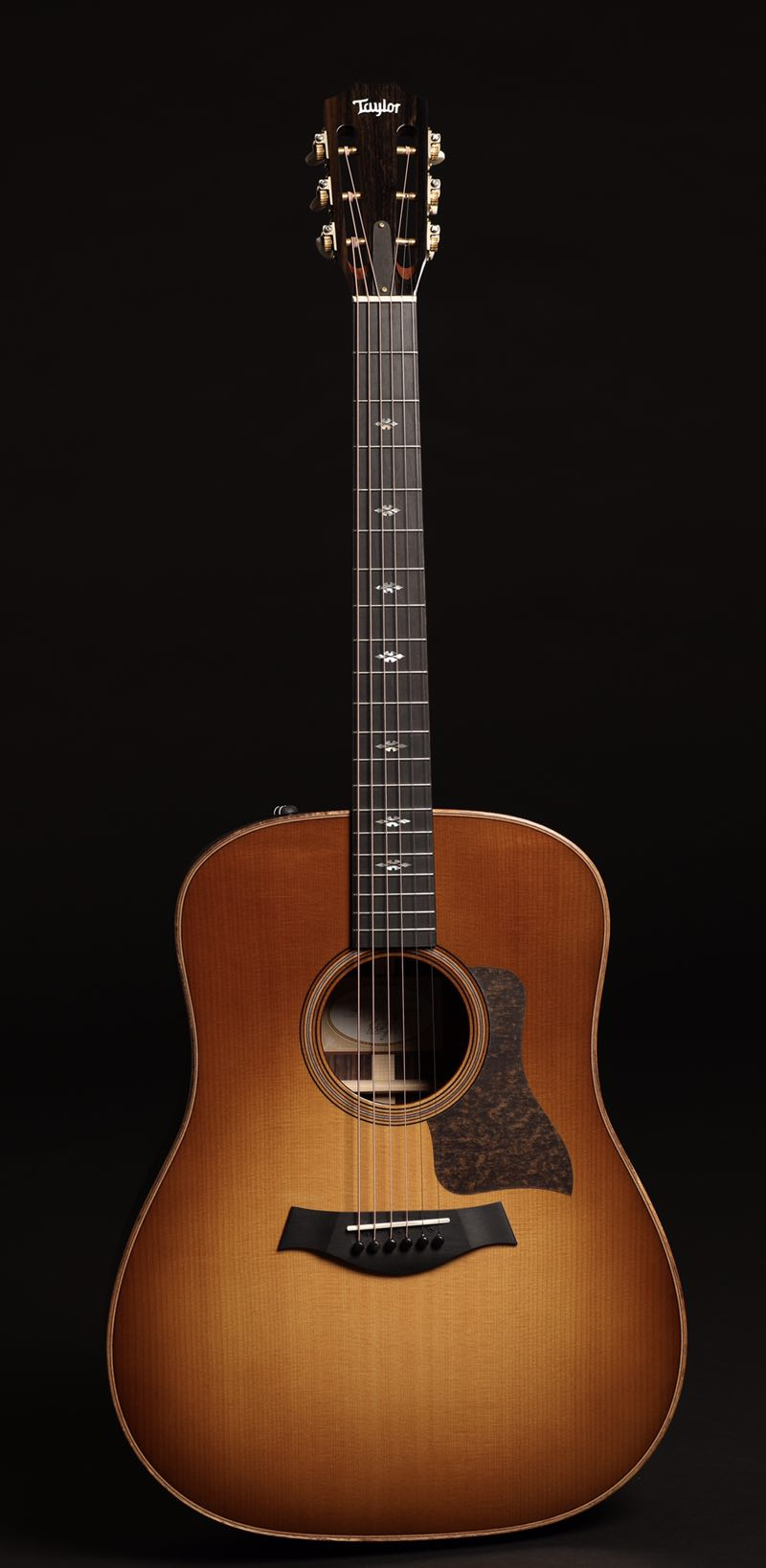 The Taylor 710e Western Sunburst Features A Lutz Spruce Top Over Indian Rosewood Back And Sides This Wood Combination Not Only Lends Itself To Vintage