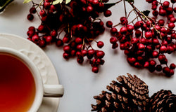 Tea with berries and pinecones