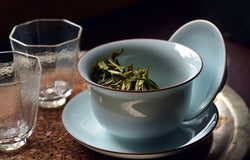 Tea cup with loose leaf green tea