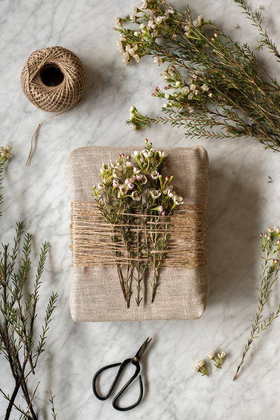 Gift wrap with string and flowers