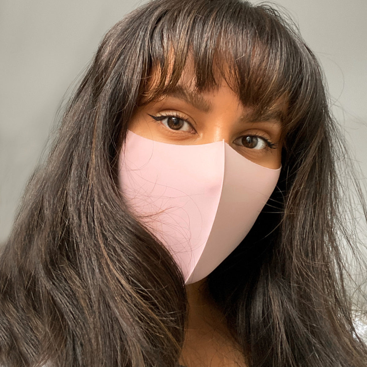 Face Coverings: What Benefits Are They Actually Covering?