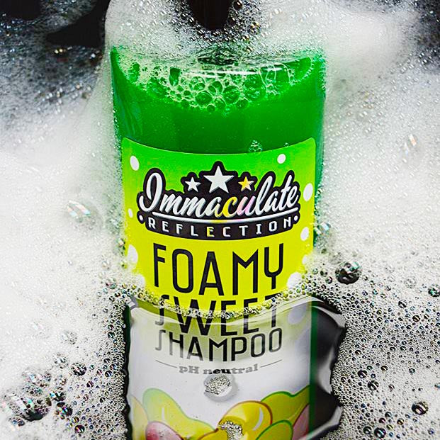 Immaculate reflection car care jelly beans foamy shampoo in bubbly water.