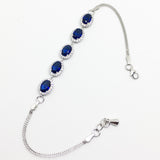 SILVER OVAL BLUE AND WHITE CUBIC ZIRCONIA HALO BRACELET
