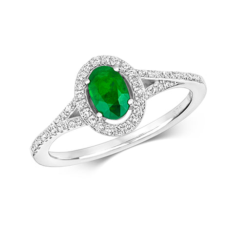 9CT WHITE GOLD OVAL EMERALD AND DIAMOND HALO RING WITH DIAMOND SPLIT SHOULDERS