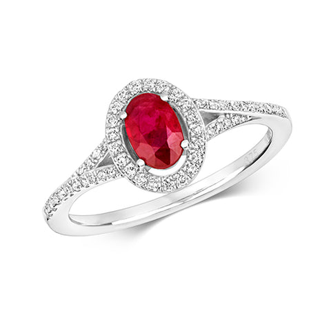 9CT WHITE GOLD OVAL RUBY AND DIAMOND HALO RING WITH DIAMOND SPLIT SHOULDERS