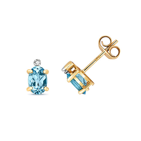 9CT GOLD OVAL BLUE TOPAZ & DIAMOND STUDS