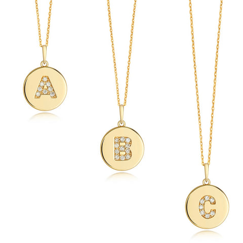 9CT GOLD DIAMOND SET INITIAL DISC PENDANT