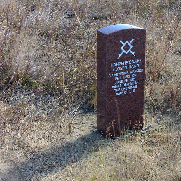 A Marker stone on the battlefield honoring Cheyenne warrior Closed Hand