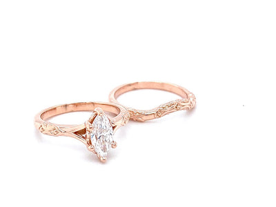 rose-gold-marquise-moissanite-wedding-ring-wexford-jewelers