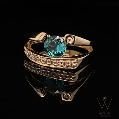 blue-green-topaz-yellow-gold-ring-wexford-jewelers