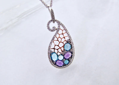blue-topaz-amethyst-rose-cut-two-tone-gold-pendant-wexford-jewelers